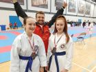 Georgia and Niamph celebrating with Sensei Oli Hampson